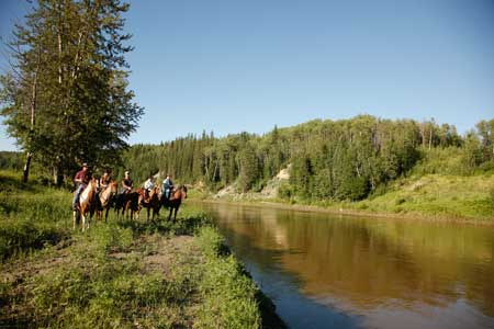 Lakeview Guest Ranch Cattle Drives riders overlooking river